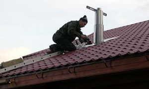 Как вывести трубу через крышу из профнастила